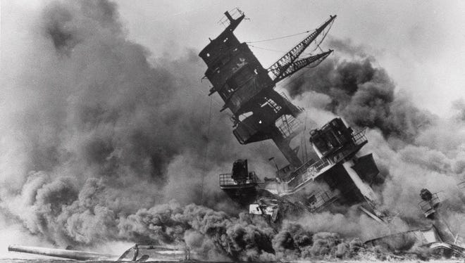 """ADVANCE FOR WEEKEND EDITIONS MAY 24-27--FILE--This Dec. 7 1941 file photo shows the terrible results of the Japanese surprise attack on Pearl Harbor as the USS Arizona went down in flames and smoke. The $135 million epic """"Pearl Harbor"""" debuts on Memorial Day weekend promising a ferocious re-creation of the Japanese sneak-attack that plunged the United States into WWII.  (AP Photo/USS Arizona Memorial)"""