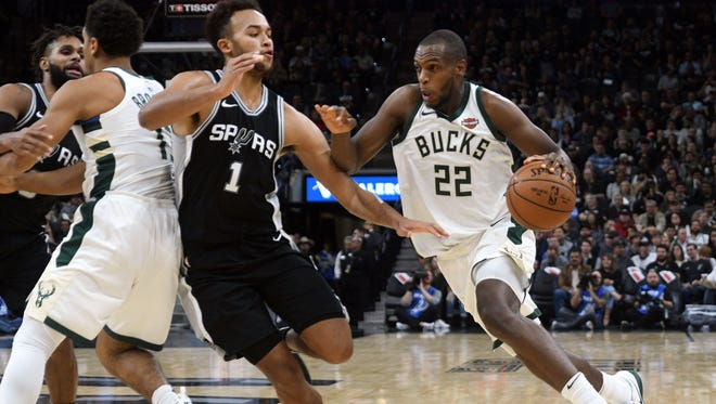 Bucks forward Khris Middleton drives to the basket against Spurs guard Kyle Anderson during the first half Friday night in San Antonio.