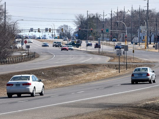 Traffic moves along County Road 75 Saturday, March