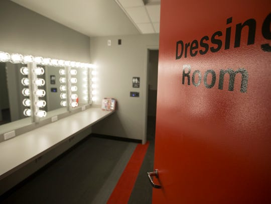 A dressing room, with its own unisex private bathroom