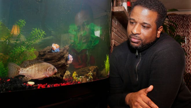 Gerald Williamson keeps three fish, the only survivors among the 2,800 he used to exfoliate customers' feet at his business eight years ago.