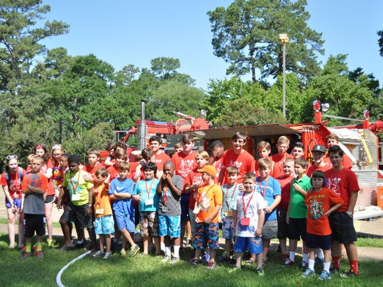 Buddy campers pose Thursday morning for a picture during the annual summer camp, held at First United Methodist Church in Alexandria, for kids with special needs.