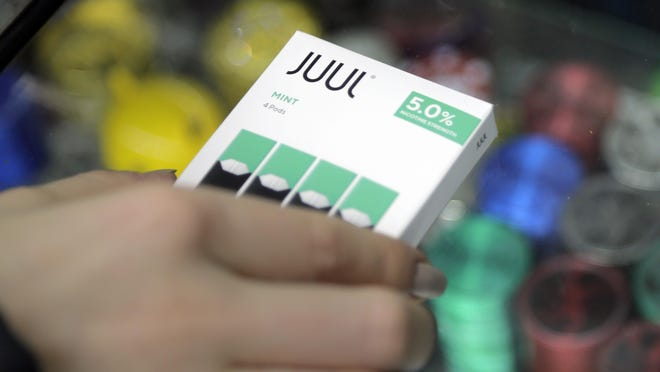 E-cigarette maker Juul Labs said Thursday that it will halt sales of its best-selling mint-flavored vaping pods.
