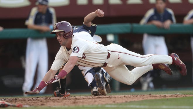 FSU's Reese Albert slides into home plate, scoring a run in the Seminoles 12-2 win over Mount St. Mary's at Dick Howser Stadium on Friday, May 11, 2018.