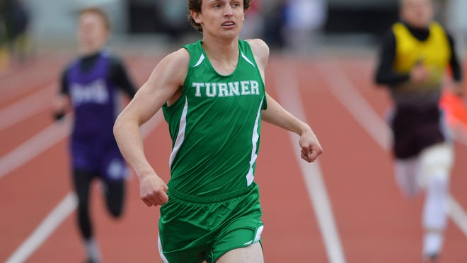Turner's Eddie Harmon checks his time as he crosses the finish line in the 800m run during the Ralph Halverson Northern C Divisional Track Meet two weeks ago at Memorial Stadium.