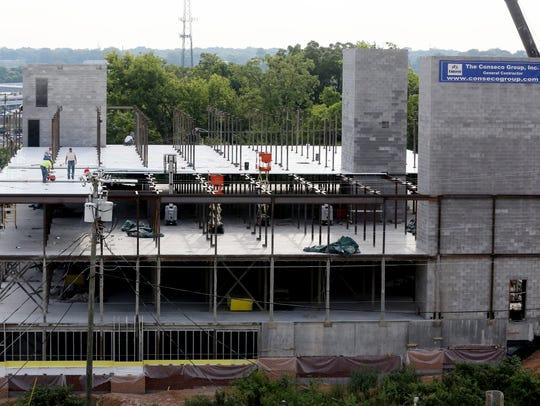 Workers tend to the construction site for Melrose Storage