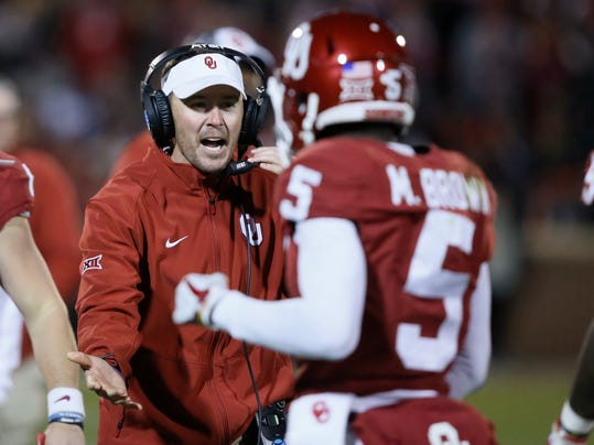 "FILE- In this Oct. 28, 2017, file photo, Oklahoma coach Lincoln Riley greets wide receiver Marquise Brown (5) as he comes back to the bench during the third quarter of an NCAA college football game against Texas Tech in Norman, Okla., Saturday, Oct. 28, 2017. The most straightforward championship game scenario for the Big 12 would be No. 3 Oklahoma and No. 11 TCU both winning their remaining two games and meeting again Dec. 2. Then again, nothing ever seems to come that easy for the Big 12. ""Look, there's never a perfect answer. We've always said that, and everybody knows that,"" Riley said. ""The best thing being is you're going to have the best two teams in the league playing again there on the last week."" (AP Photo/Sue Ogrocki, File)"