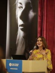 Storyteller Brianna Westphal speaks during a Kids in
