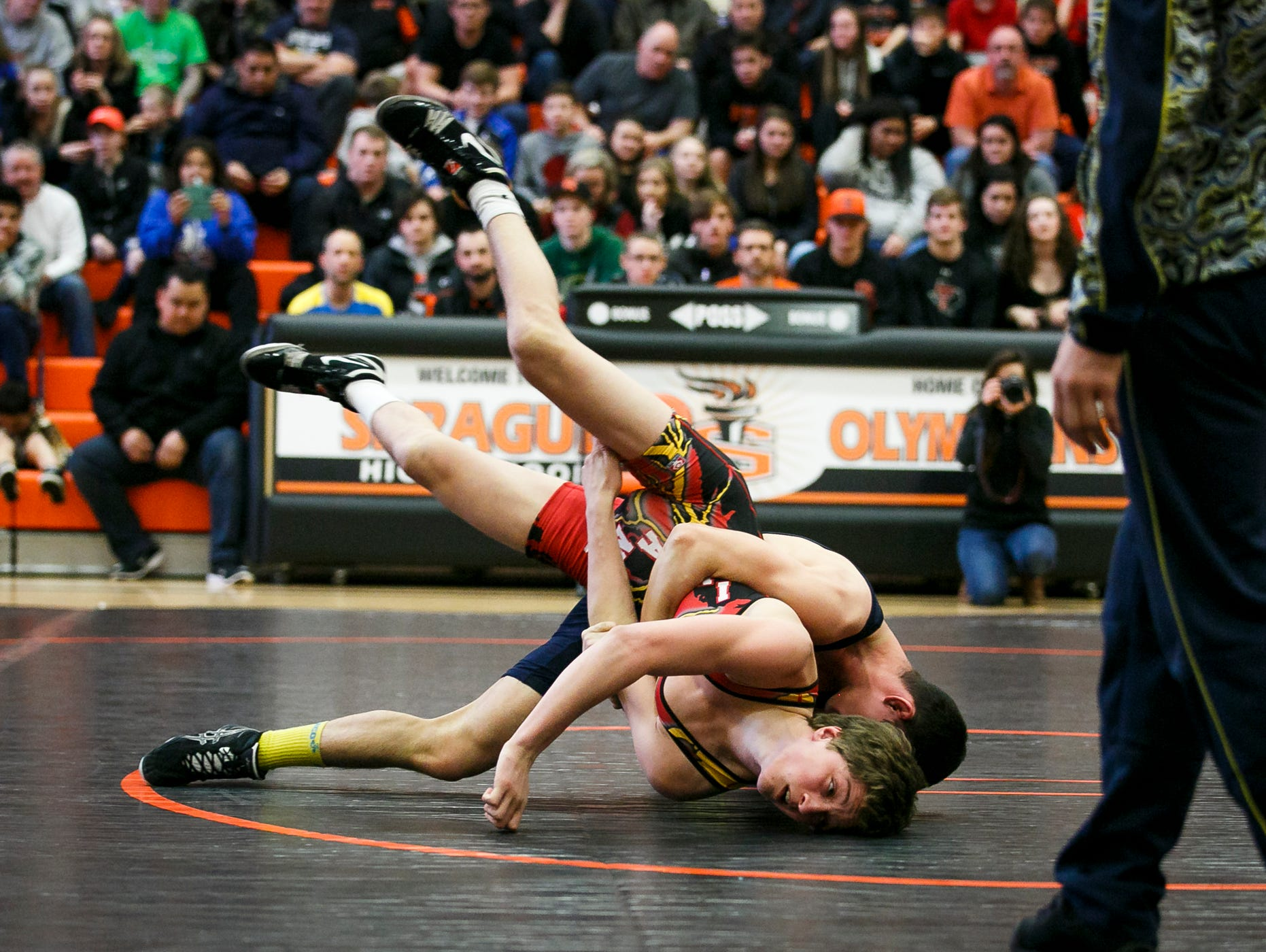 Ukraine's Andrii Dzhelep tries to pin Sprague's Daniel McClung in a match at Sprague High School on Tuesday, March 8, 2017. McClung was the Oregon state runner up in the 126 pound division in 2017; Dzhelep is a 2016 cadet world champion in the 17 and under division.