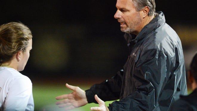Merritt Island girls soccer coach Scott Carswelll talks with a player during Friday's Class 3A regional final.