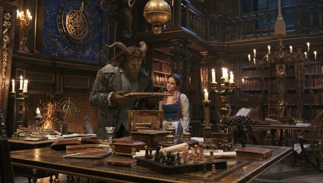 "Dan Stevens as The Beast, left, and Emma Watson as Belle in a scene from the live-action adaptation of the animated classic ""Beauty and the Beast."""