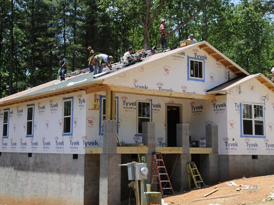 Habitat for Humanity house being constructed by the Asheville Home Builders Association in one week in Enka Hills.