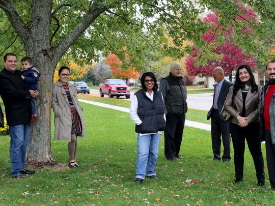 Brenda McKinney, center, the first African American elected treasurer for Superior Township, loves the fact that she lives in one of the most diverse communities in Michigan. She gathered on Oct. 17, 2014, with some of the people who call the township home: (from left) Karina Aguirre, with her husband, Roberto Gaytan, and their son, Roger Gaytan; Hyum Choi; (behind McKinney) Ken Schwartz; John Chun; and Nahid Yahyai and her husband Matthew Yahyai.