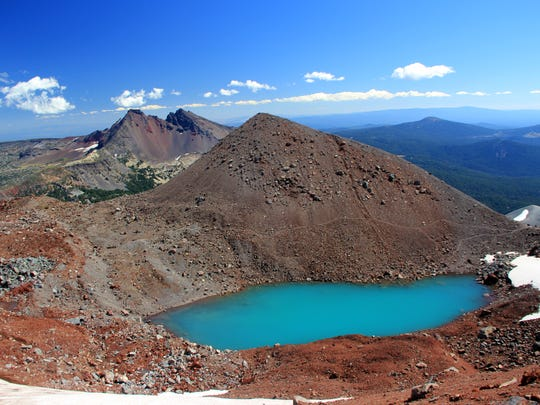 A climb up South Sister takes you past this snow tarn at the false summit around 8,844 feet.