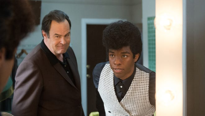 Dan Aykroyd, left, and Chadwick Boseman star in the new James Brown biopic 'Get on Up.'