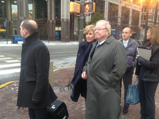 Don Marsh (in gray coat), the former CEO of Marsh Supermarkets, heads tofederal court in Indianapolis on Feb. 4, 2013.