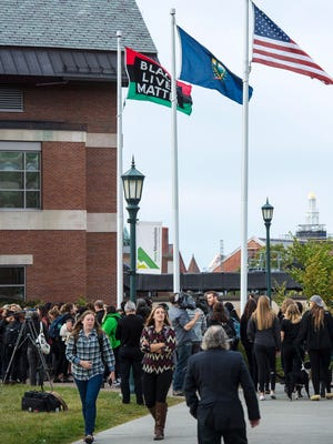 Supporters of the Black Lives Matters movement gather in front of the Davis Center at the University of Vermont in Burlington on Monday, September 26, 2016. The demonstration was called after a BLM flag that had been flying on campus was stolen. The flag has since been raised again.