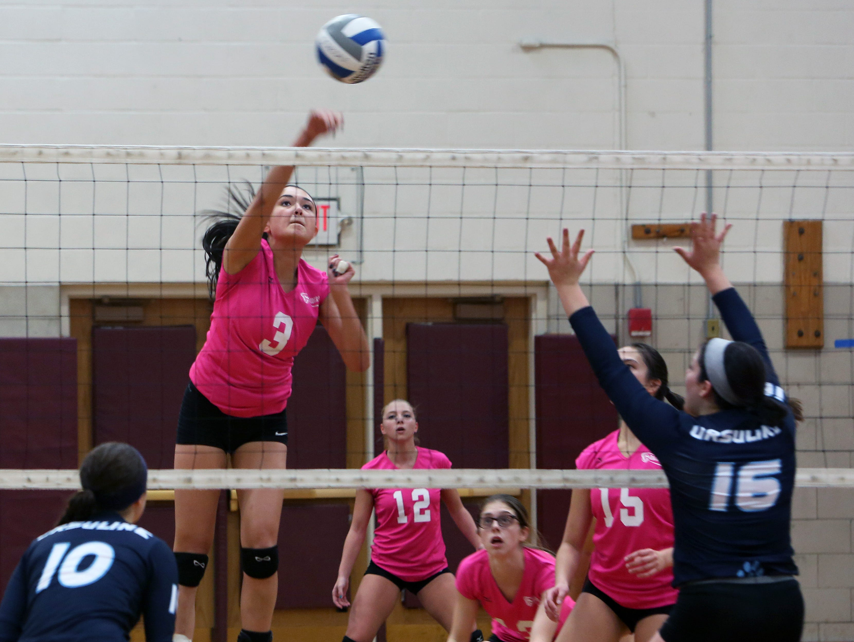 Scarsdale's Tatiana Tiango (3) gets a shot by Ursuline's Rebecca Caruso (16) during volleyball action at Scarsdale High School Oct. 20, 2015. Scarsdale swept Ursuline, 25-20, 25-16, and 25-23.