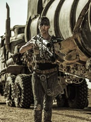 Imperator Furiosa (Charlize Theron) guards her truck