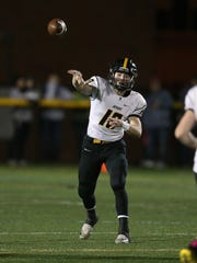 McQuaid quarterback Hunter Walsh steps into a throw against Schroeder. Walsh completed 70 percent of his passes while throwing for 1,578 yards and 20 touchdowns as a junior in 2017.