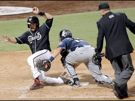 El Paso's Austin Hedges is called safe at home after knocking the ball loose from the glove of Reno catcher Matt Pagnozzi Thursday night at Southwest University Park.