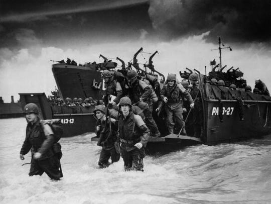 Reinforcements disembarking from a landing barge at