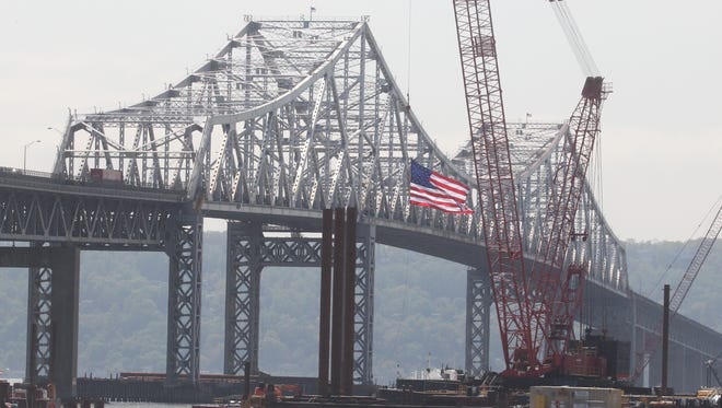 A flag is displayed on the Tappan Zee Bridge over construction vessels on May 14, 2014.