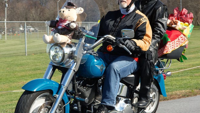 Hundreds of motocyclists - and passengers - took part in Saturday's Henderson County Toy Run to benefit local children in foster care. The 23rd annual event began at Bill Moore Community Park in Fletcher  and ended at the County Courthouse in Hendersonville.