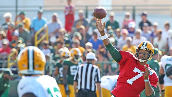 Green Bay Packers quarterback Brett Hundley (7) throws to wide receiver Randall Cobb (18) during training camp Monday, July 31, 2017 at Ray Nitschke Field in Ashwaubenon, Wis.