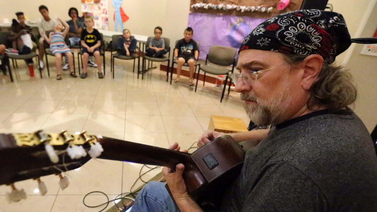 Jamie O'Hara, a magician and musician, performs a song Wednesday for children enrolled in the El Paso Holocaust Museum and Study Center's summer camp.