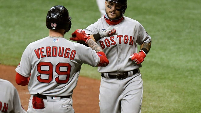 Michael Chavis, right, joined Alex Verdugo in the outfield Tuesday in Boston's first game of a doubleheader in Philadelphia.