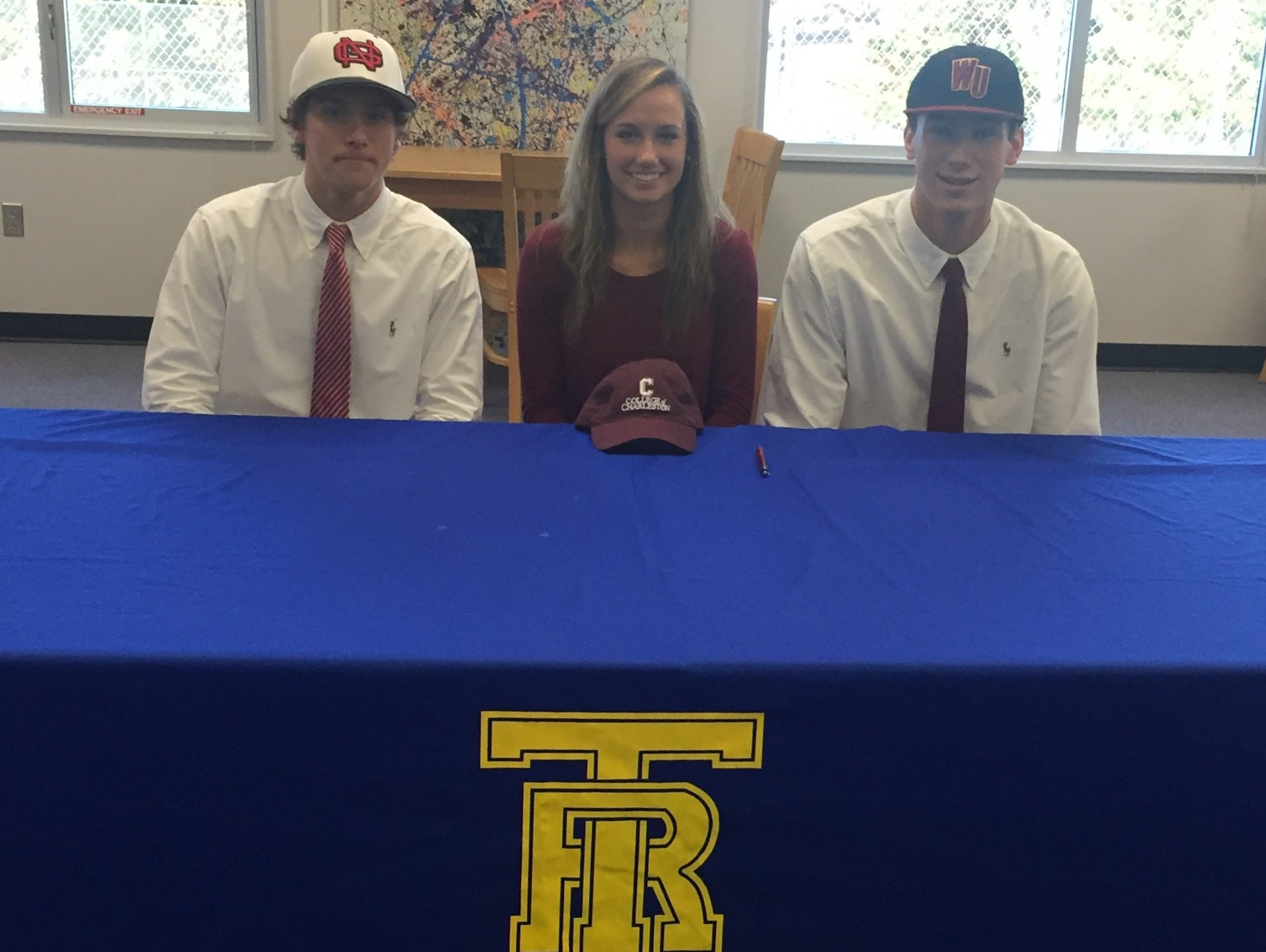 At Travelers Rest, from left, Parker Neff signed with North Greenville for baseball, Victoria Huskey with College of Charleston for golf and Jason Crumley with Winthrop for baseball.