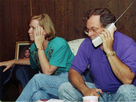 Stuart McCall takes a phone call as Janis sits near on June 9, 1992.