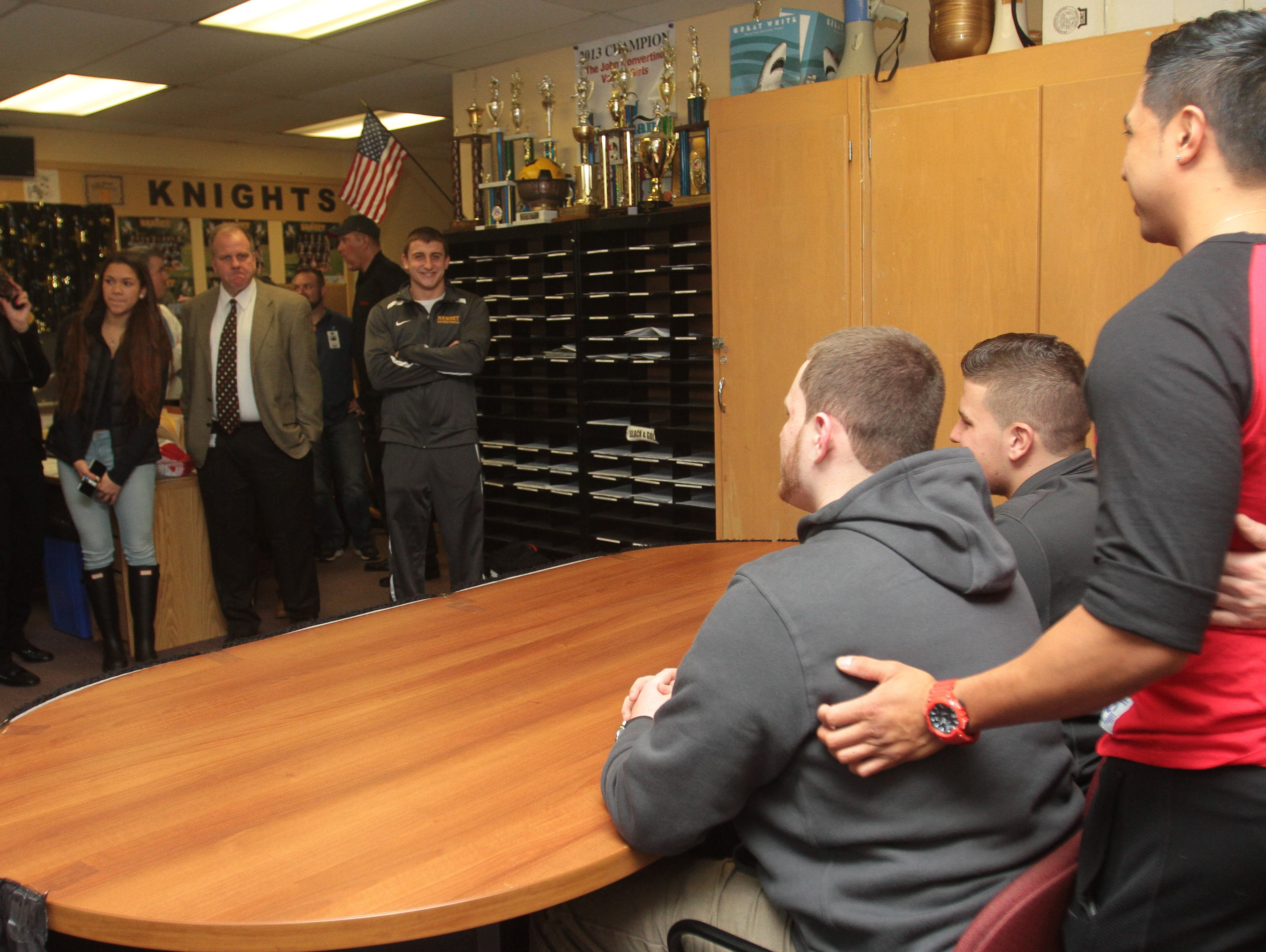 Friends, family and the coaching team took turns taking photos with Jordan Landsman and Brian Syracuse on Feb. 3, 2016 at Nanuet Senior High School.