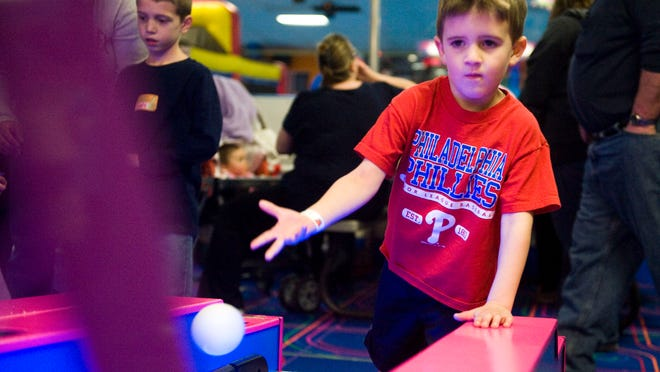 Tyler Cornog, 4, of Haddon Twp, plays skee-ball at the Deptford Skating & Fun Center, February 3, 2013 in Westville.