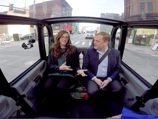 Alisyn Malek, chief customer officer for May Mobility, and Edwin Olson, CEO, ride their autonomous shuttle bus being tested by Bedrock on Dec. 4, 2017, in downtown Detroit.