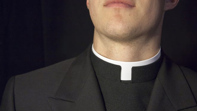 Close-up of Priest collar with black background.
