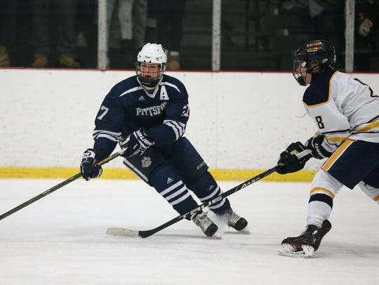 Pittsford's Hayden Feck carries the puck against Victor's