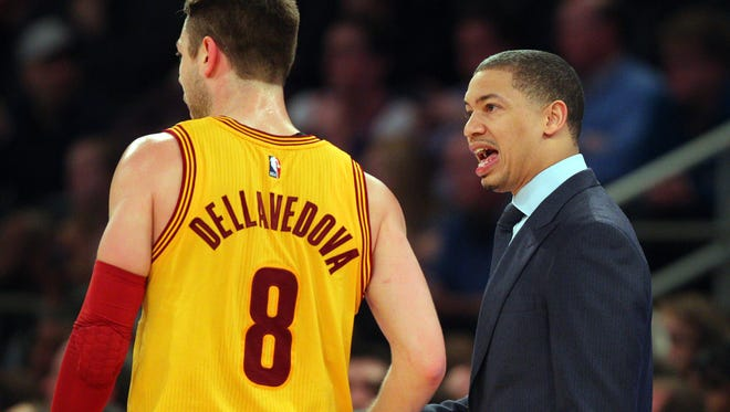 Mar 26, 2016; New York, NY, USA; Cleveland Cavaliers head coach Tyronn Lue coaches Cleveland Cavaliers point guard Matthew Dellavedova (8) against the New York Knicks during the fourth quarter at Madison Square Garden.