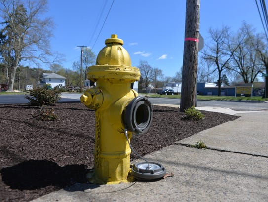 The cap remains off of a Main Street fire hydrant after