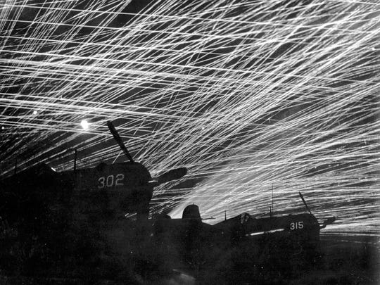 Japanese night raiders are greeted with a lacework of antiaircraft fire by the U.S. Marine defenders of Yontan airfield.