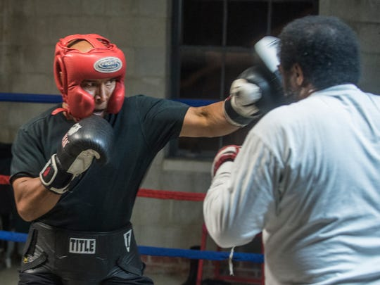 Sarge Ruffin, 60, does pad work with coach Eddie Hayes on Monday, Jan. 8, 2018, at Faith Boxing in Montgomery. It's been 30 years since Ruffin was in an official amateur boxing match, and he'll have one this weekend at the Sugar Bert Boxing National Qualifier at Montgomery's Cramton Bowl Multiplex.