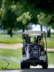Participants hit the links during the 2013 U.S. Venture Open at North Shore Golf Club in Menasha.