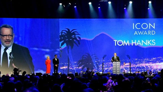 Tom Hanks speaks from the podium after receiving the Icon Award at the Palm Springs Film Awards on Monday, Jan. 2.