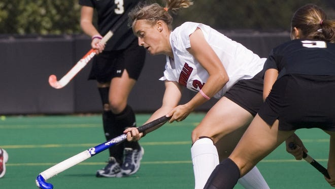 In this file photo from Oct. 8, 2005, Jessica Javelet passes for Louisville during a field hockey match against Wake Forest.