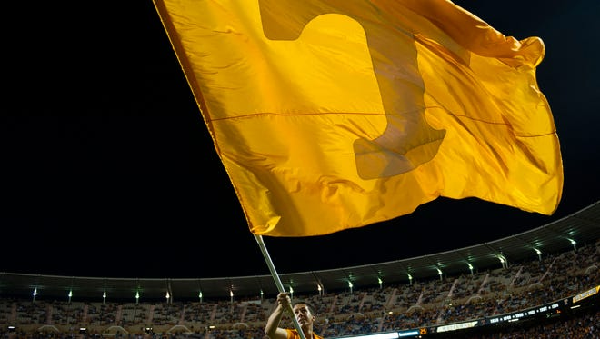 A Tennessee flag waves before fans during the game between Tennessee and Southern Miss at Neyland Stadium in Knoxville, Tennessee, on Saturday, Nov. 4, 2017.