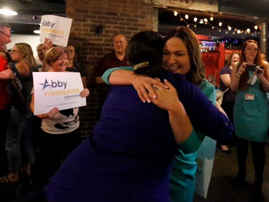 State Rep. Abby Finkenauer greets supporters at The Smokestack in Dubuque after winning a Democratic primary for Congress on Tuesday, June 5, 2018. Finkenauer was one of four Democrats facing off in Tuesday's primary election to represent their party in this fall's election against Republican U.S. Rep. Rod Blum.