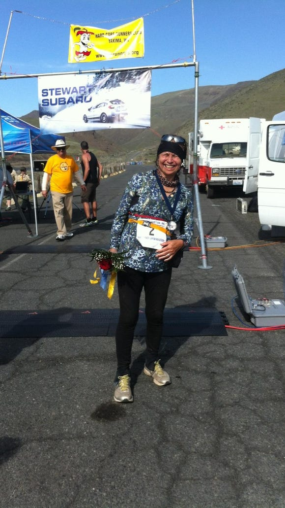 Fenny Roberts at the finish line of the Yakima River Canyon Marathon on April 2, 2016, her 200th marathon.
