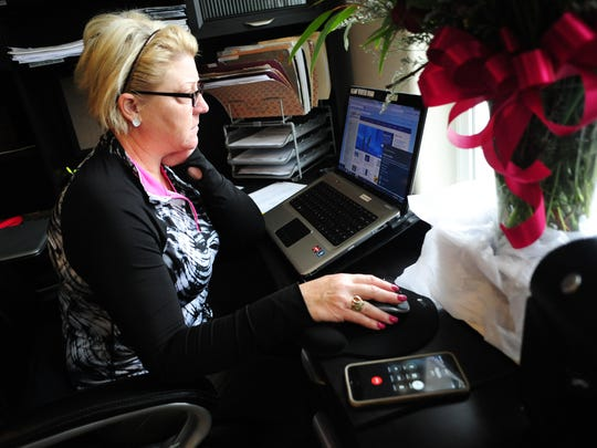 Sherri Jemison, owner of Amazing Grace Care Homes, works at her computer while on hold with TripLink, on Friday, May 22, 2015, in Salem. At the time of the call she was 18th in line.