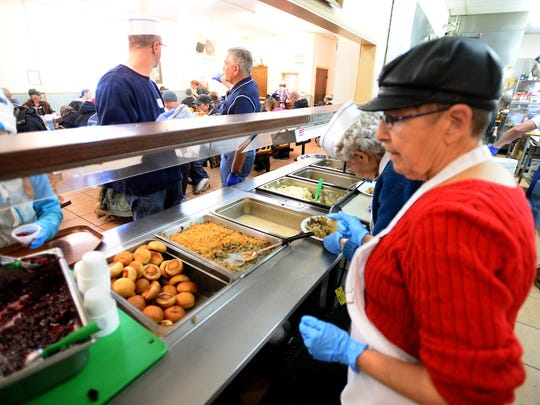 Volunteers help serve 150-160 turkey dinners at the Great Falls Rescue Mission Thursday.